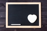 Slate chalk board on wooden background