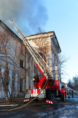 Firefighters extinguish a burning palace of culture