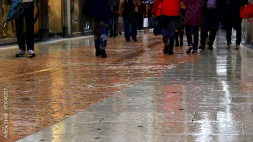 People walking on the rainy street.