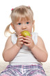 Portrait of a little girl eating an apple