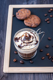 Coffee with whipped cream and chocolate chip cookies