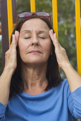 Relaxed mature woman meditating