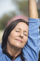 Portrait relaxed mature woman closed eyes
