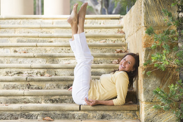 Confident happy mature woman legs up outdoor