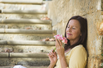 Romantic mature woman in love with rose