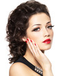 Beautiul fashion model with red manicure and lips