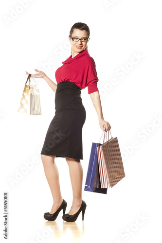 happy and smiling blue-eyed brunette holding shopping bags