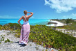 Girl looking along the coastline of Little Exuma, Bahamas
