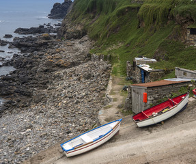 Fishing boats and huts on slipway on shore