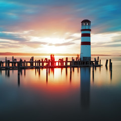 Ocean lighthouse sunset