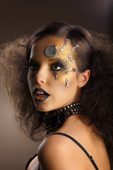 Futurism. Bodyart. Golden Painted Woman's Skin. Silver Accessory