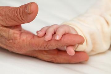 Baby Holding Great Grandma's Finger