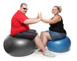 Overweight woman with her personal fitness trainer.