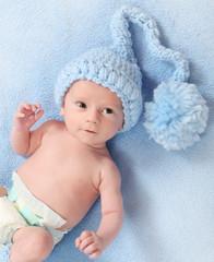 Healthy baby boy in funny knited cap.