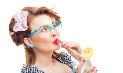 Profile of woman drinking lemonade or cocktail
