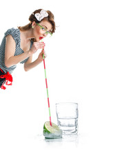 Woman drinking juice with straw, creative