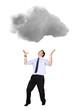 Business man lifting a cloud