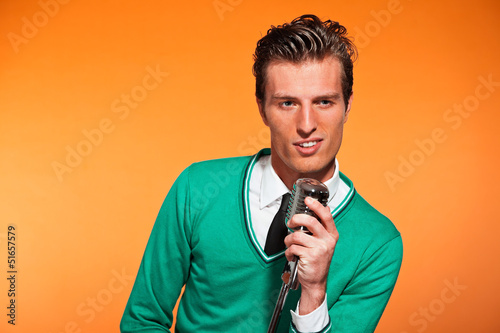 Retro fifties style rock and roll singer with green shirt.