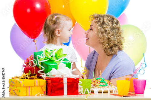 Baby and mother celebrate first birthday holiday