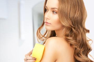 beautiful woman with sponge