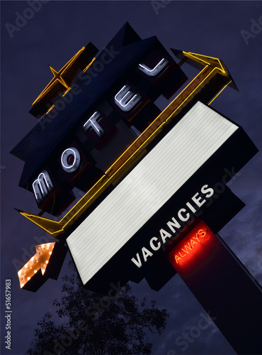Old neon motel sign at dusk with copyspace