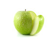 Isolated sliced green apple with water drops.