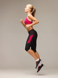 sporty woman running or jumping