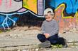 Little boy sitting sulking