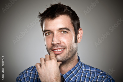Portrait of a normal boy over grey background.