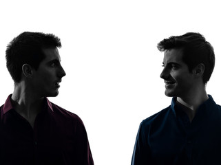 two  men twin brother friends looking at each others silhouette