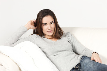 Cutel smiling woman on sofa