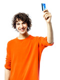 young man happy holding credit card portrait