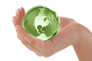 Green globe in female hand