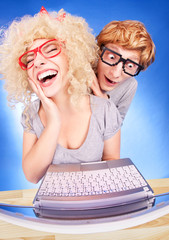 Funny couple is using laptop computer