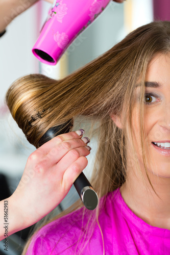 Woman at the hairdresser having hair dried