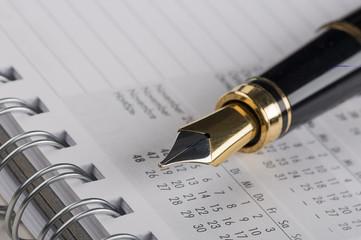 Füller auf Kalender