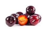 Red plum fruit isolated on white background.  Fresh ripe washed