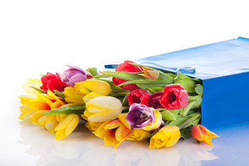 bouquet of tulip flowers in the blue bag