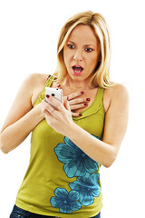 Surprised woman reading shocking sms text message