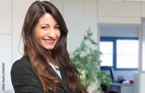 Happy businesswoman in her office