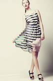 Selfhood. Funky Woman wearing Stylish light Fluttering Dress