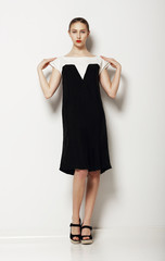 Minimalism. Woman Fashion Model in Comfy Contrast Dress. Comfort