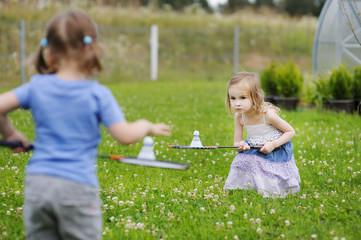 Kids sisters playing badminton