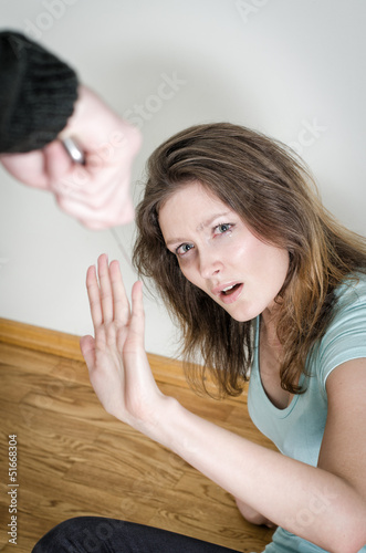 Man with knife coming to his wife. Home violence concept