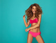 Young beautiful woman in pink swimsuit with fashion hairdo