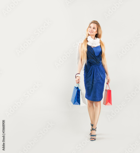Beautiful Woman in Blue Dress with Shopping Bags