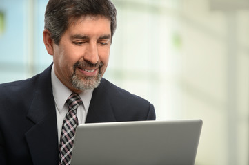 Hispanic Businessman Using Laptop