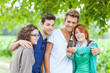Group of Teenage Friends Taking Self Portraits with Mobile Phone