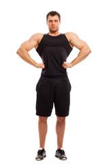 Bodybuilder in fitwear posing isolated