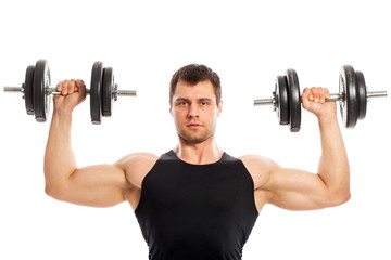 Handsome muscular guy working out